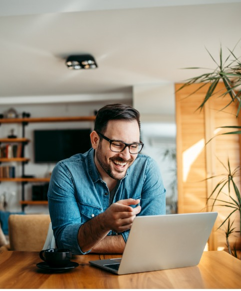 Portrait Of A Handsome Man Laughing While Looking At Laptop Picture Id1257664212